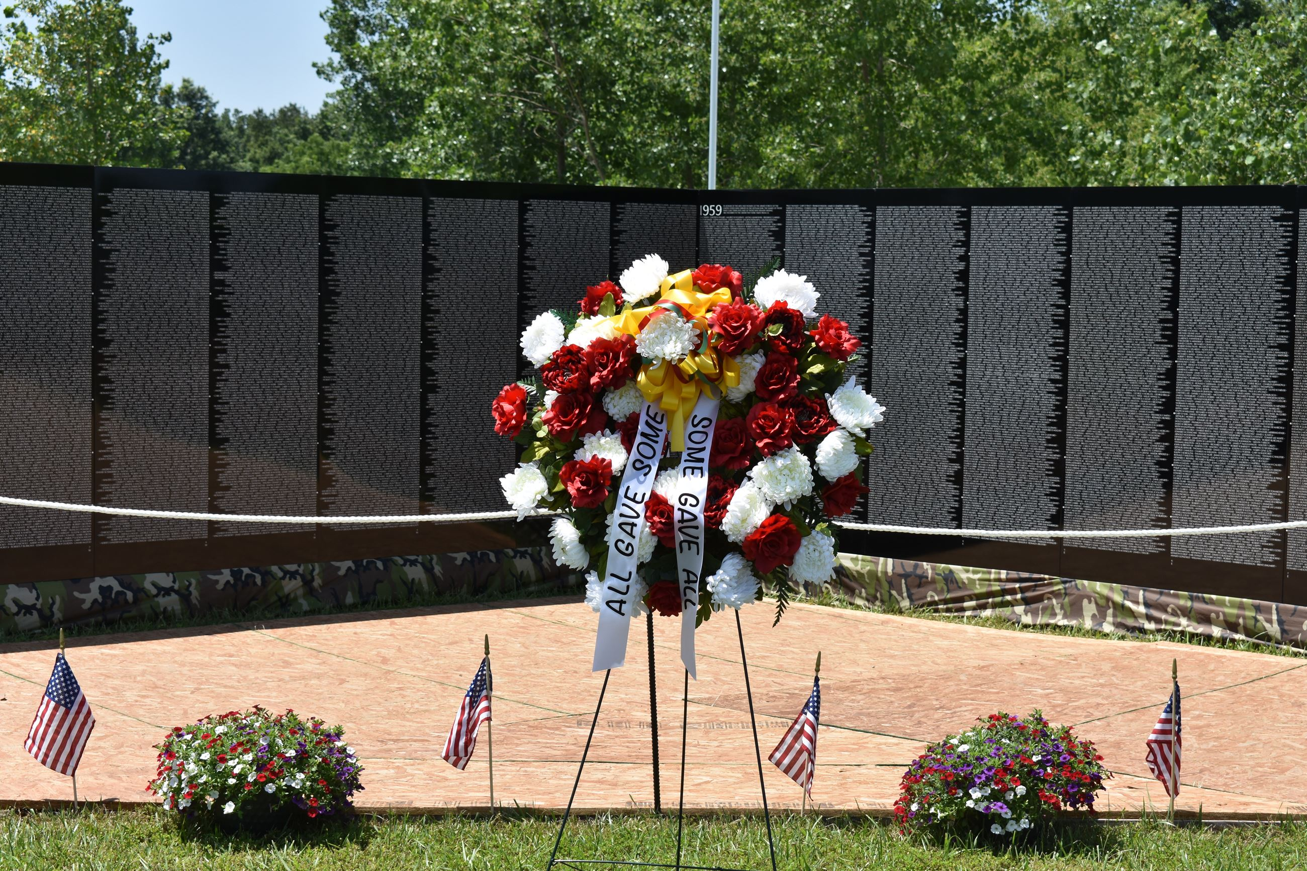 A wreath of honor placed in front of The Moving Wall traveling Vietnam Veterans memorial.
