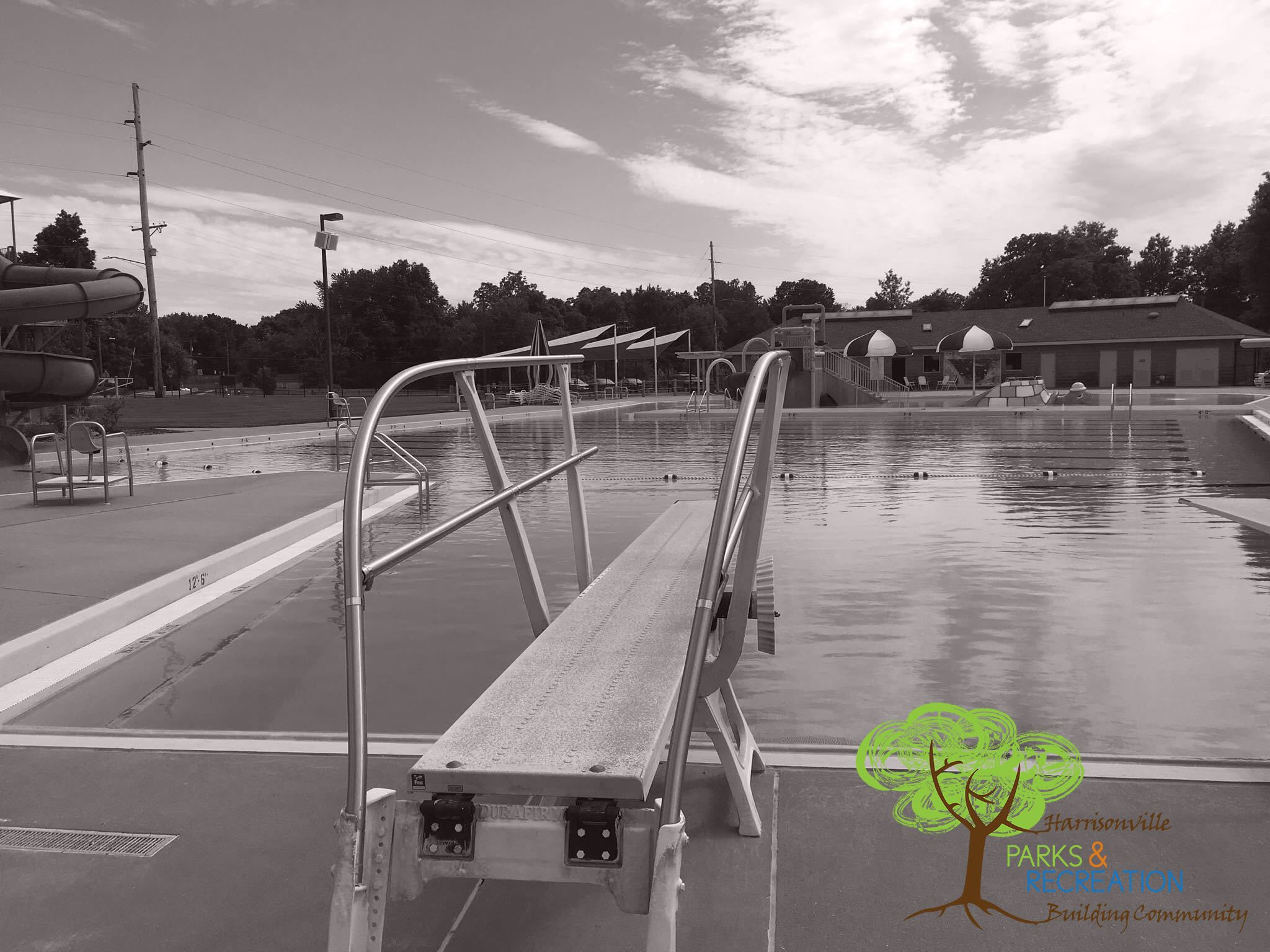 Black and white Harrisonville Aquatic Center with PR logo