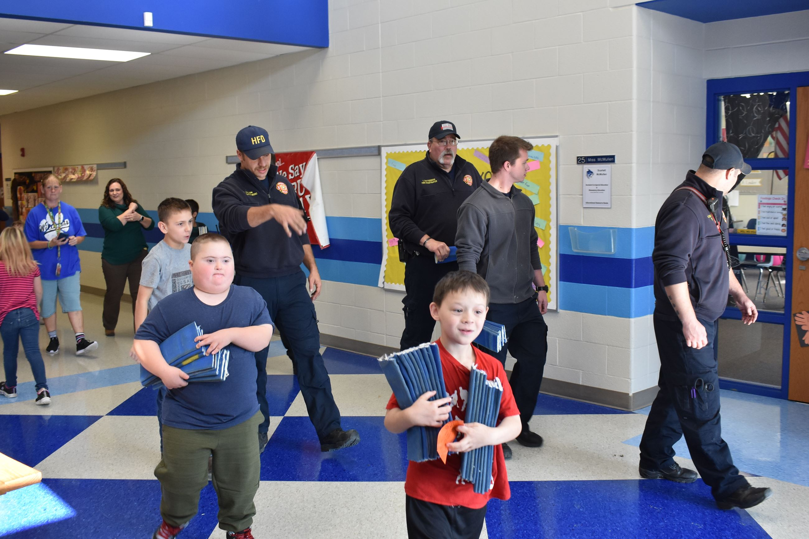Harrisonville EMS and HES Life Skills students hand out new classroom security device